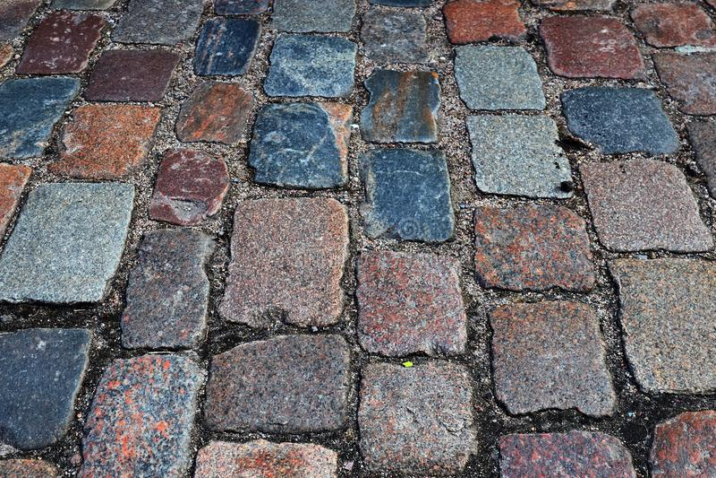 Zakończenie w górę widoku inne perspektywy na brukowiec ziemi powierzchniach brać na północnych Germany ulicach fotografia royalty free