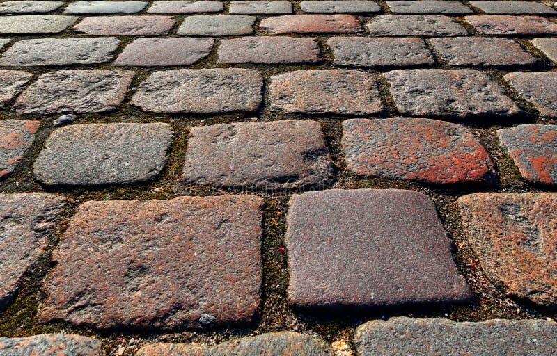 Zakończenie w górę widoku inne perspektywy na brukowiec ziemi powierzchniach brać na północnych Germany ulicach zdjęcia royalty free