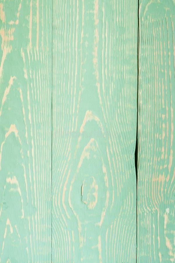 Zakończenia drewniany tło z ogłoszonym wzorem na zieleni malującej wsiada fotografia stock