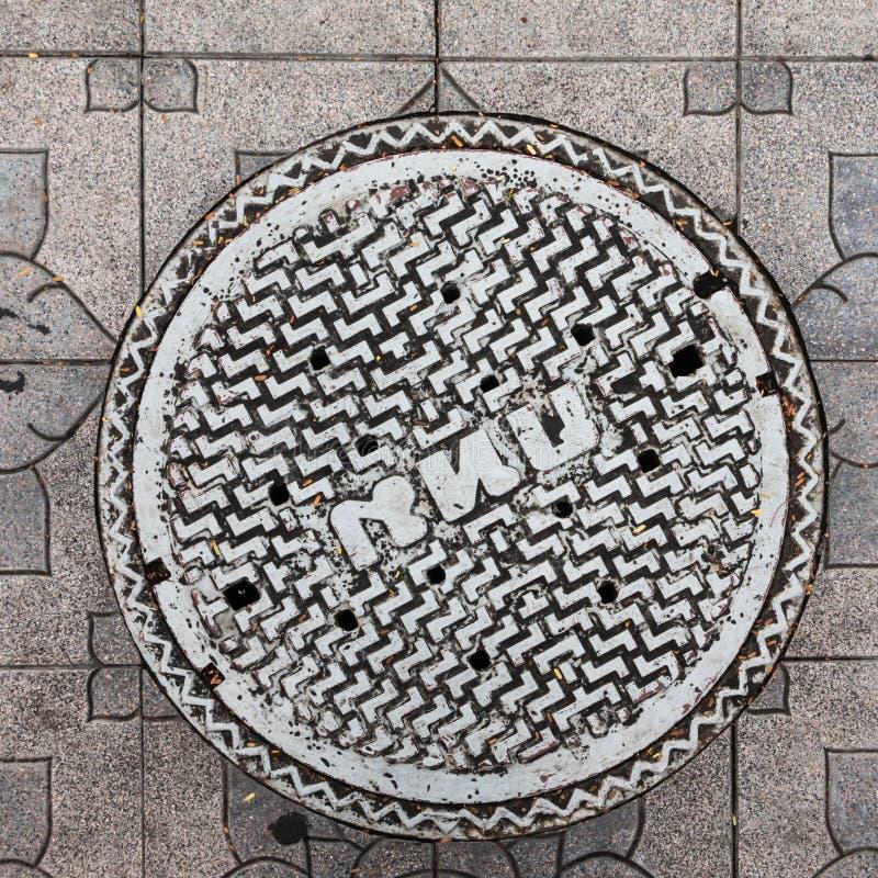 Zakończenie metalu manhole pokrywa zdjęcie royalty free
