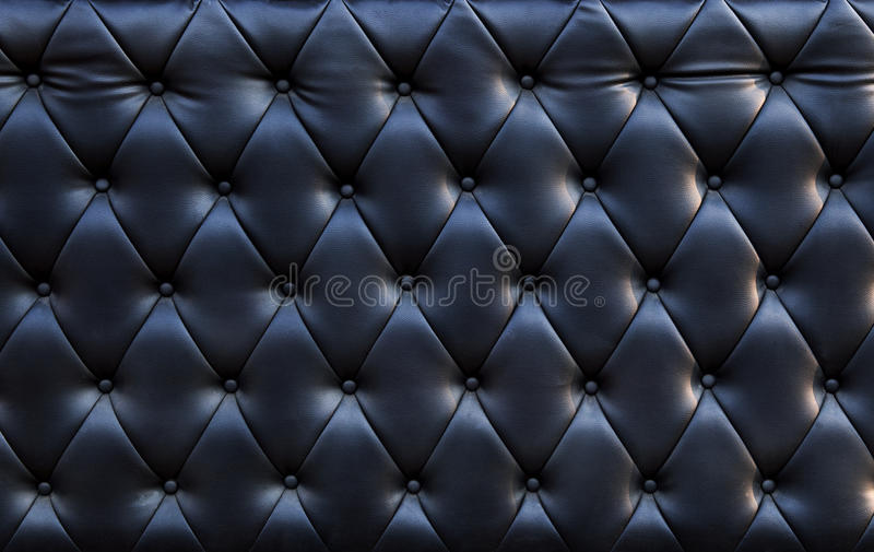 Zakończenie up czarniawej luksusowej kanapy tekstury rzemienny use jak textured zdjęcie royalty free
