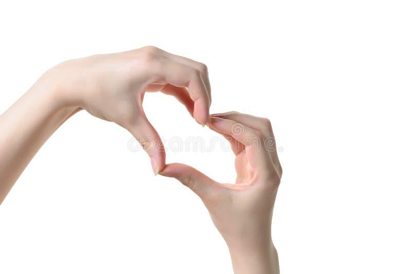 Zakończenie up serce robić kobiet rękami z bladą skórą odizolowywającą zdjęcia stock