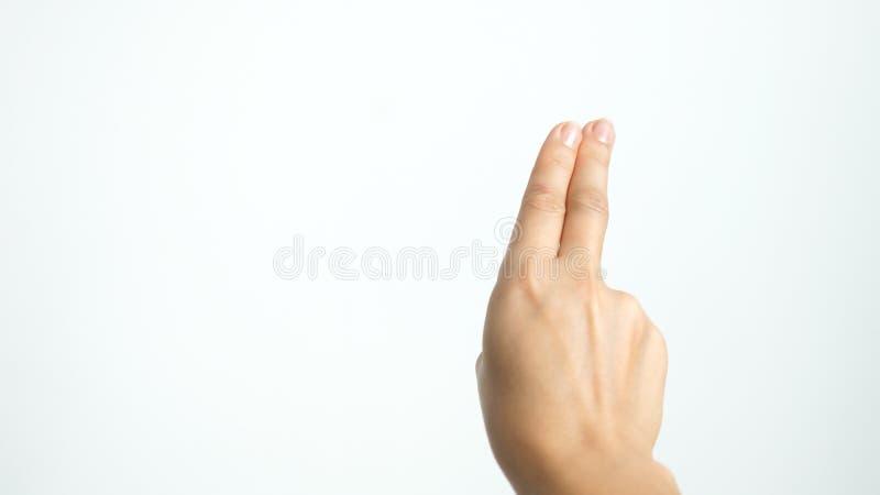 Zakończenie w górę odosobnionych żeńskich ręk przedstawień dwa palca w górę odosobnionego na białym tle obrazy stock