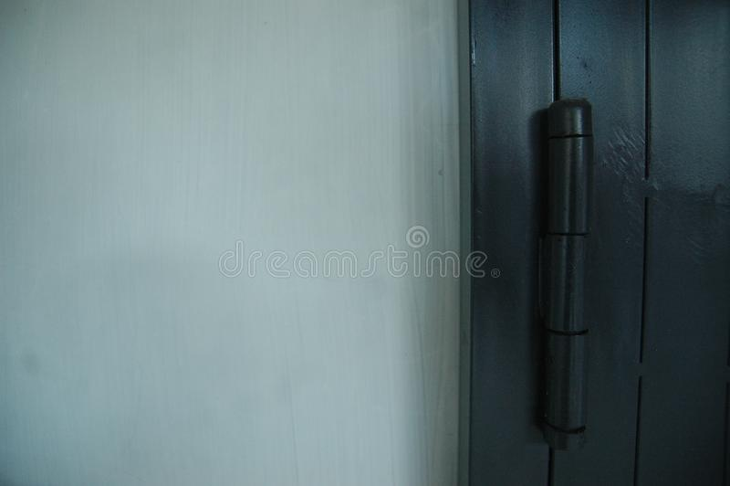 Zakończenie w górę tocznej drzwiowej czarnej koloru szczegółu tekstury - metal zdjęcie royalty free