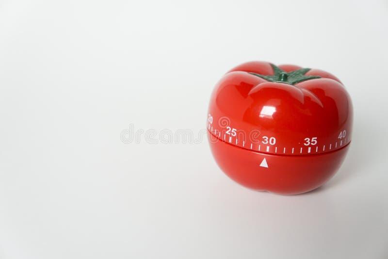 Zakończenie w górę widoku machinalny pomidor kształtujący kuchnia zegaru zegar dla gotować i studiować Także używać dla pomodoro  obrazy stock