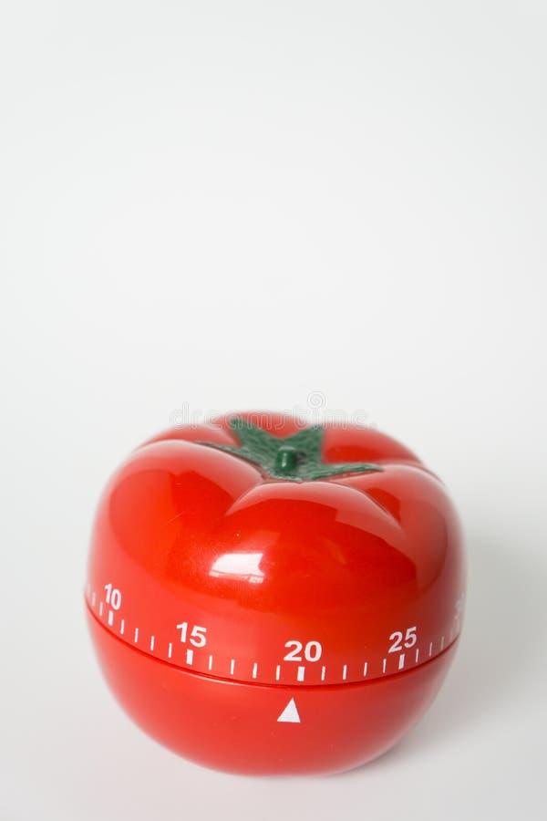 Zakończenie w górę widoku machinalny pomidor kształtujący kuchnia zegaru zegar dla gotować i studiować Używać dla pomodoro techni zdjęcie stock