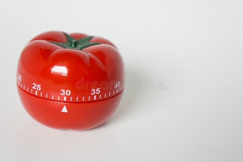 Zakończenie w górę widoku machinalny pomidor kształtujący kuchnia zegaru zegar dla gotować i studiować Używać dla pomodoro techni obrazy stock