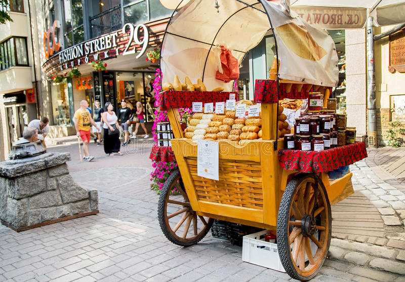 Zakopane, Poland - August 24, 2015: Oscypek cheeses, polish food. Zakopane, Poland - August 24, 2015: Oscypek cheeses and other polish traditional food sales on royalty free stock photography