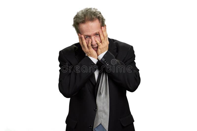 zakrywający deprymującą twarz wręcza jego mężczyzna fotografia stock