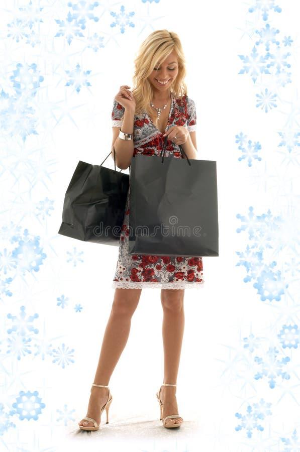 Zakupy dziewczyna z płatkami śniegu zdjęcie stock