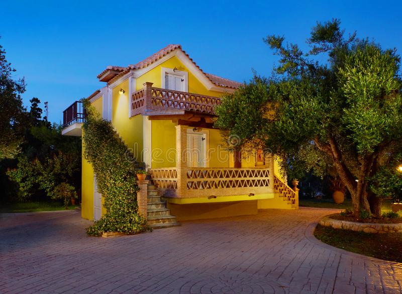 ZAKYNTHOS ISLAND, GREECE, MAY,30, 2016: Evening view on yellow classic Greek villa house cottage terrace Porto Gerakas villa in ol royalty free stock photography