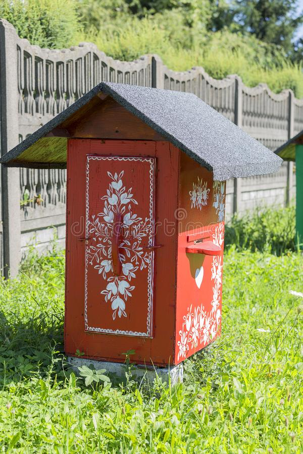 Old wooden beehives decorated with a hand painted colorful flowers, Zalipie, Poland stock images