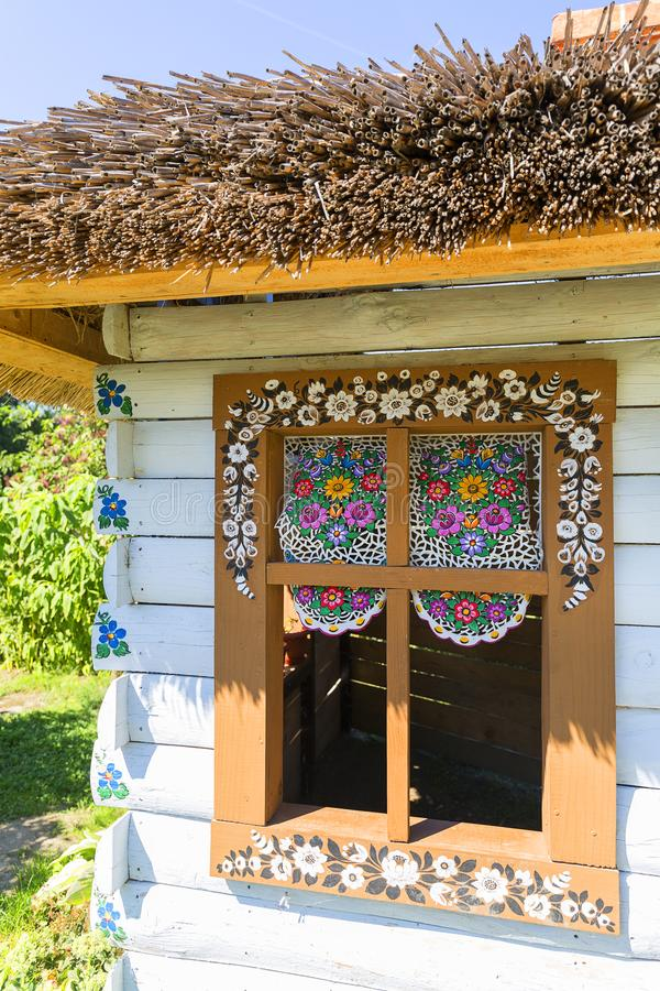 Painted old wooden cottage decorated with a hand painted colorful floral motives, folk art, Zalipie, Poland royalty free stock photo