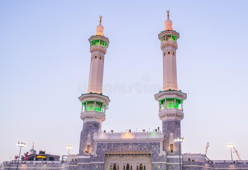 Zam-zam Tower or Clock Tower is the tallest clock tower in the world. Abraj Al Bait outside of Masjidil Haram, a holiest mosque fo. Image of Zam-zam Tower or stock photo