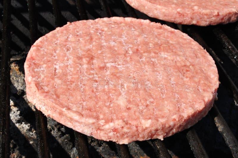 zamarznięci grilla hamburgeru paszteciki zdjęcia stock