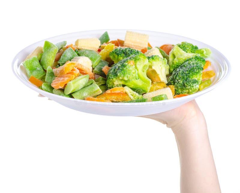 Zamarznięci warzywa na półkowym ręki mieniu zdjęcia royalty free