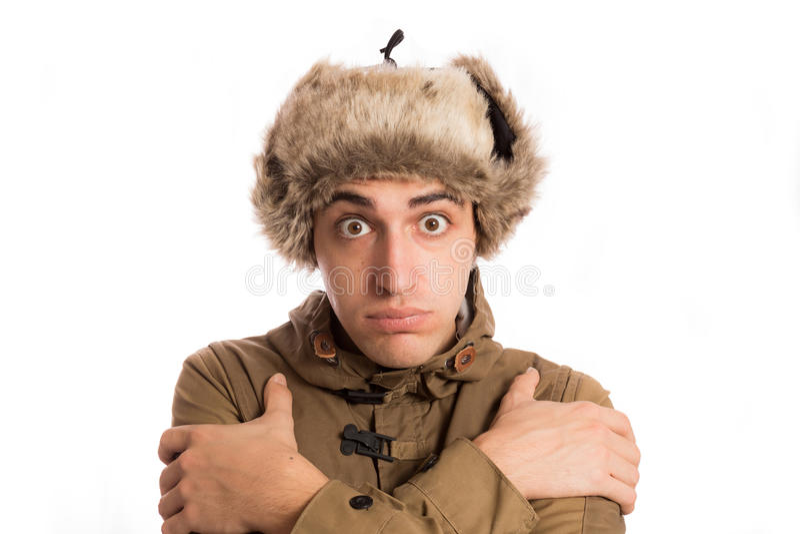 Zamarznięty mężczyzna z swój eskimo kapeluszem, odizolowywającym na bielu zdjęcia royalty free