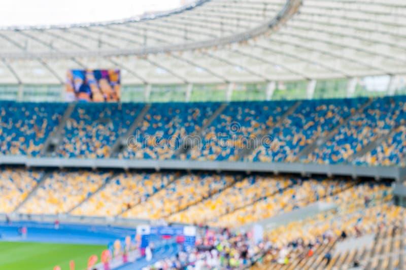 Zamazana uroczysta piłki nożnej arena, stadium z stojakami i widzami lub 2016 sportów tło obrazy royalty free