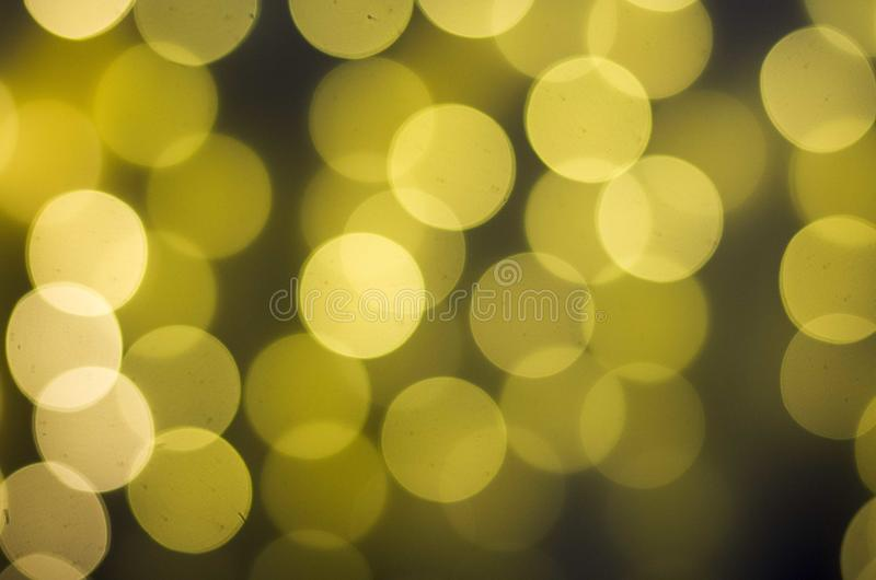 Zamazany bokeh światło w ciepłym brzmienia tle zdjęcie stock