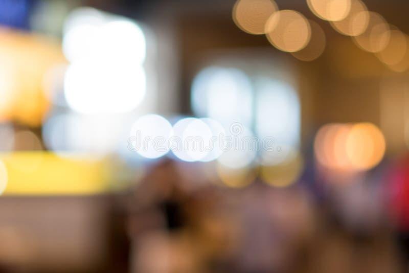 Zamazany oświetlenie przy kawową kawiarnią dla tła obrazy royalty free