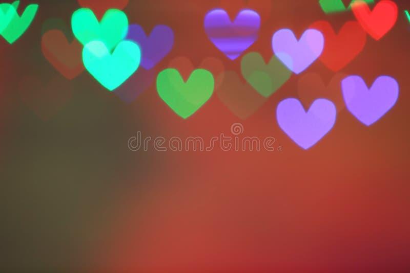 Zamazany widok piękni kierowi kształtni światła na koloru tle fotografia stock