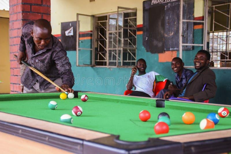 Zambian black guys play billiards royalty free stock photos