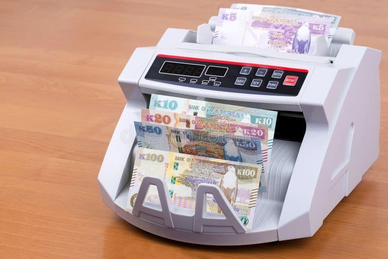 Zambian Kwacha in a counting machine royalty free stock photo