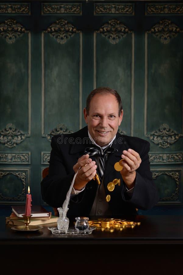 Zamożny żądny harpagon excited o jego pieniądze zdjęcie royalty free