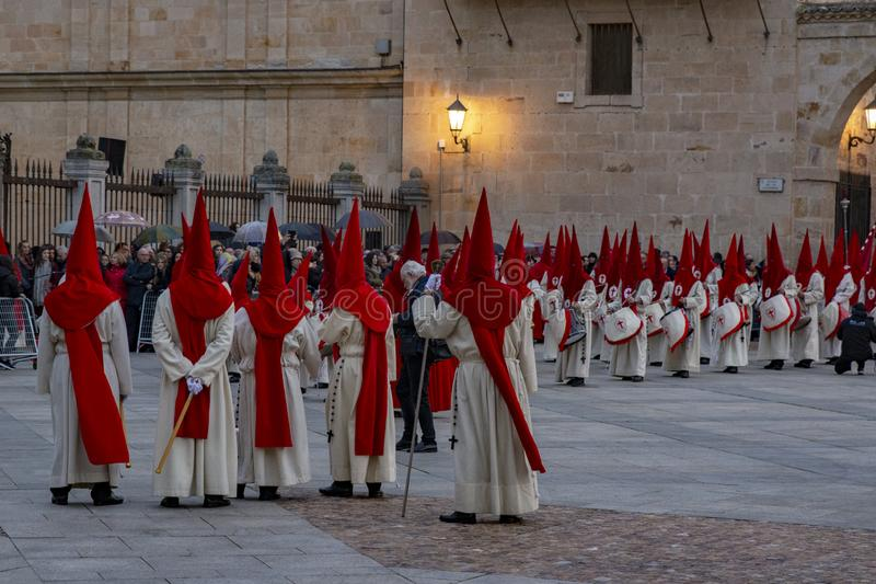 Holy Wednesday Procession in Zamora, Spain. Zamora, Spain; March 2017: Royal Brotherhood of the Holy Christ of the Injuries, parading on Holy Wednesday afternoon royalty free stock photos