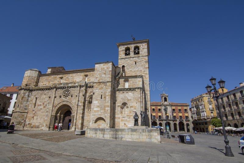 Principal facade of Church of San Juan Bautista in mayor square of Zamora with a Merlu easter statue. Zamora, Spain; September 2018: Principal facade of Church stock photography