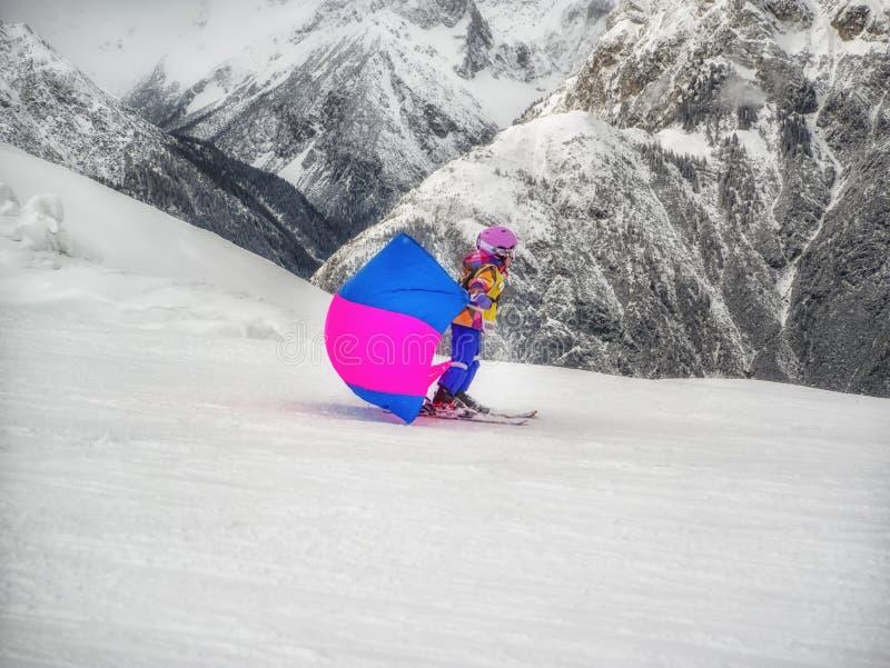 Zams, Austria - 22 Februar 2015: Children in ski school. Ski resort. Child on skis goes from mountain stock photography