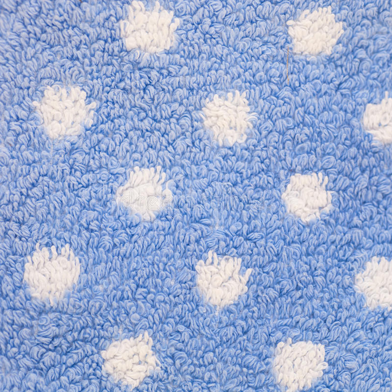 Zamyka Up Błękitny dywan z Białymi polek kropkami zdjęcie stock