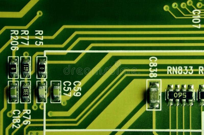 Zamyka up barwiona mikro obwód deska tło abstrakcyjna technologii Komputerowy mechanizm w szczególe zdjęcia royalty free