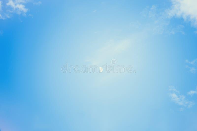 Zamyka up księżyc w ranku czasie z niebieskiego nieba tłem Narastająca księżyc obrazy royalty free