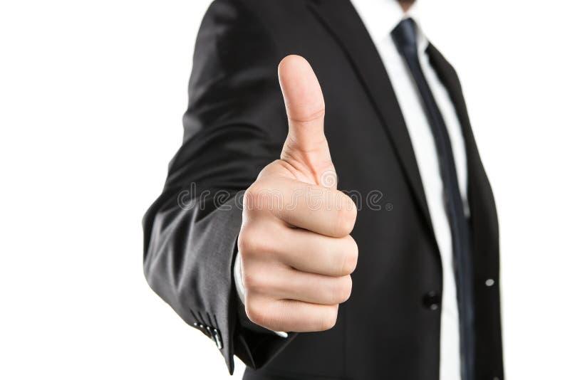 Biznesmen pokazuje aprobaty zdjęcia stock
