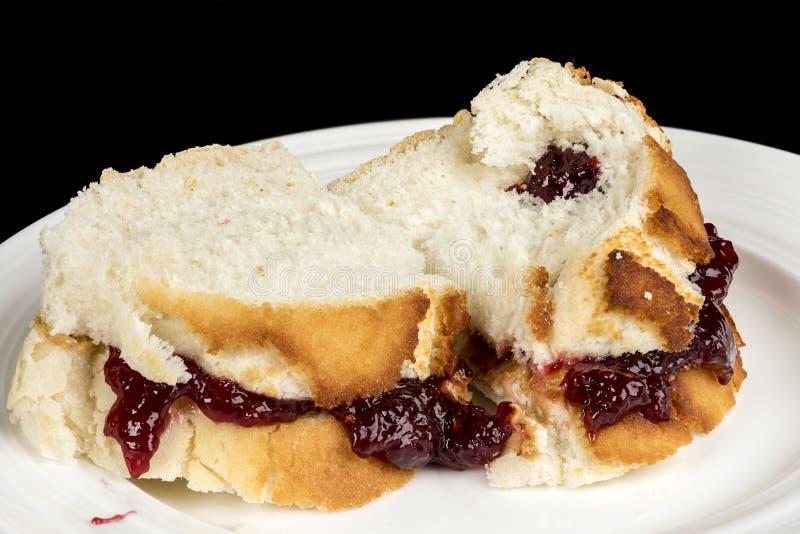 Zamyka up masła orzechowego i galarety kanapka obraz royalty free