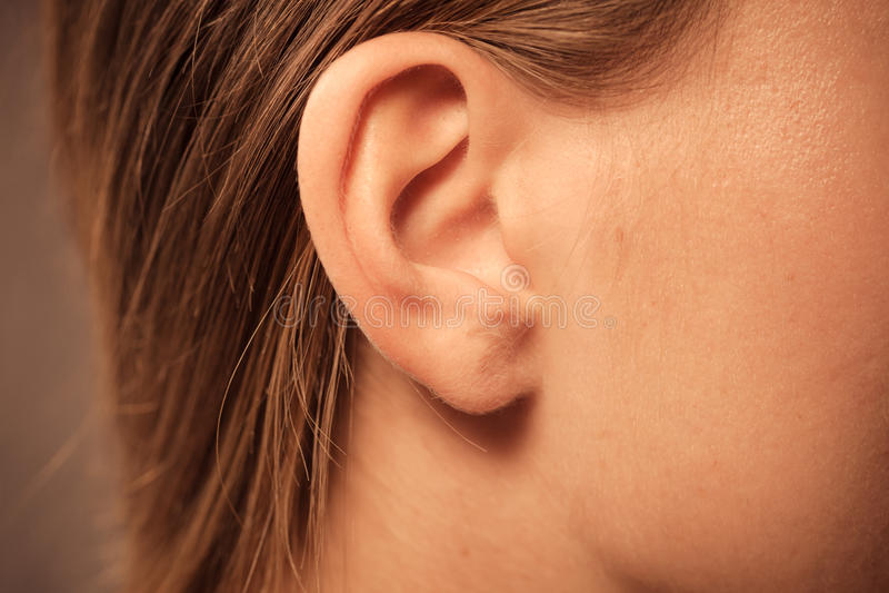 Zamyka up na żeńskim ucho obrazy stock