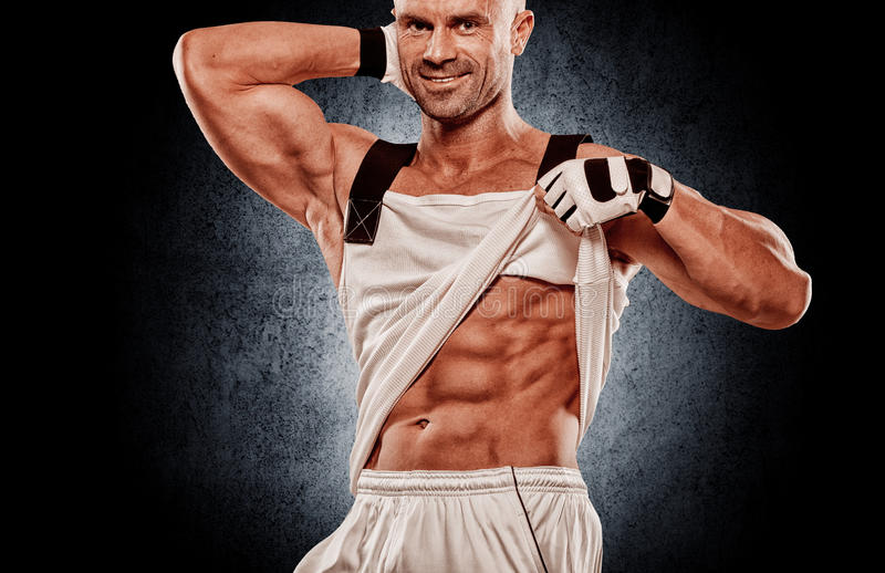 Zamyka up perfect męski ciało odizolowywający na czarnym tle z zdjęcia royalty free