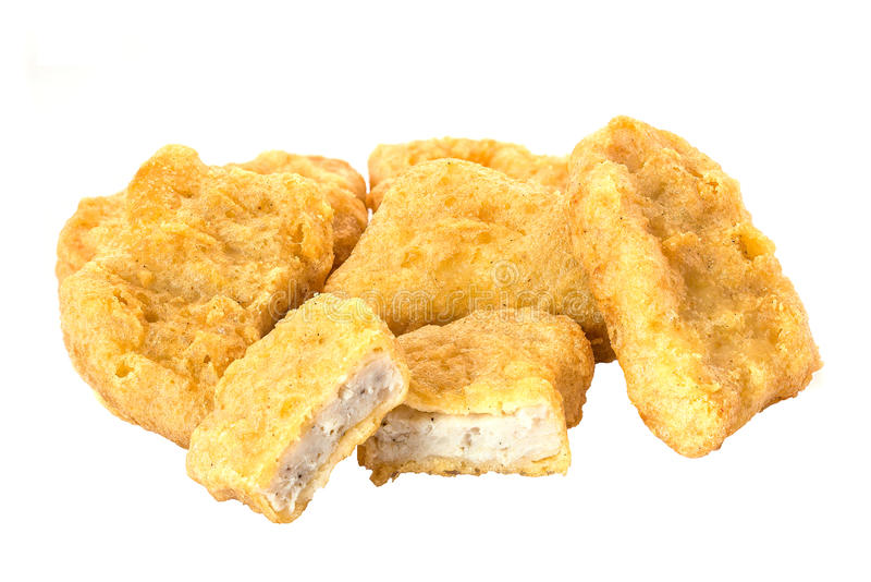 Zamyka up pieczony kurczak bryłki odizolowywać na białym tle obraz stock