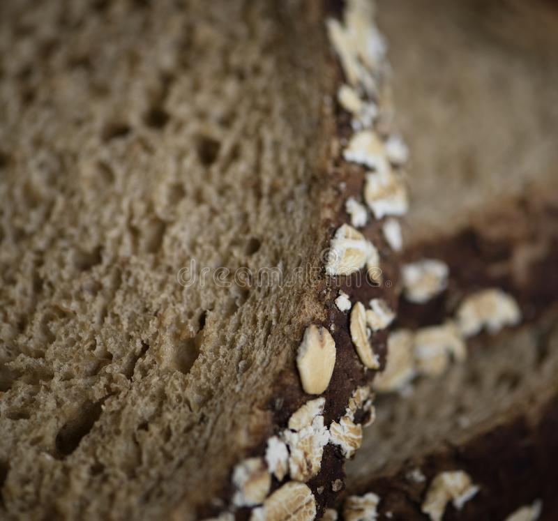 Zamyka up plasterek brown chleb obraz royalty free