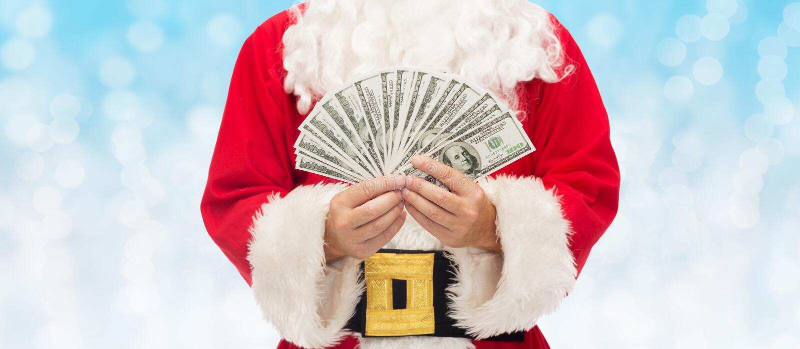 Zamyka up Santa Claus z dolarowym pieniądze obrazy royalty free