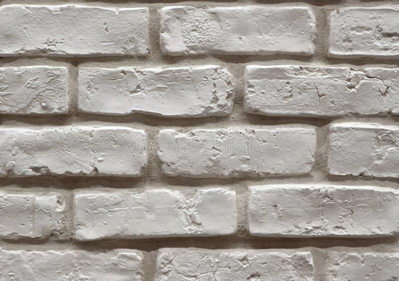Zamyka up stary zakłopotany biały ściana z cegieł, używać dla wnętrzy fotografia stock
