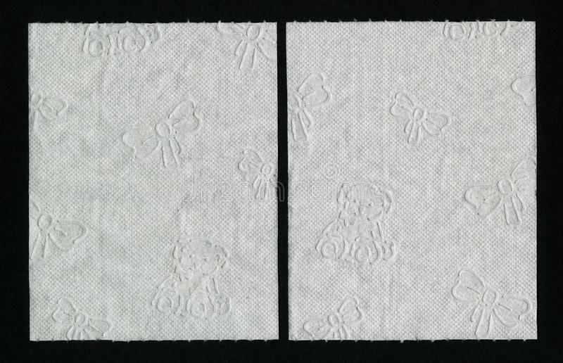 Zamyka w górę białej papier toaletowy tekstury Biały textured WC papier z dziecko ornamentem fotografia stock