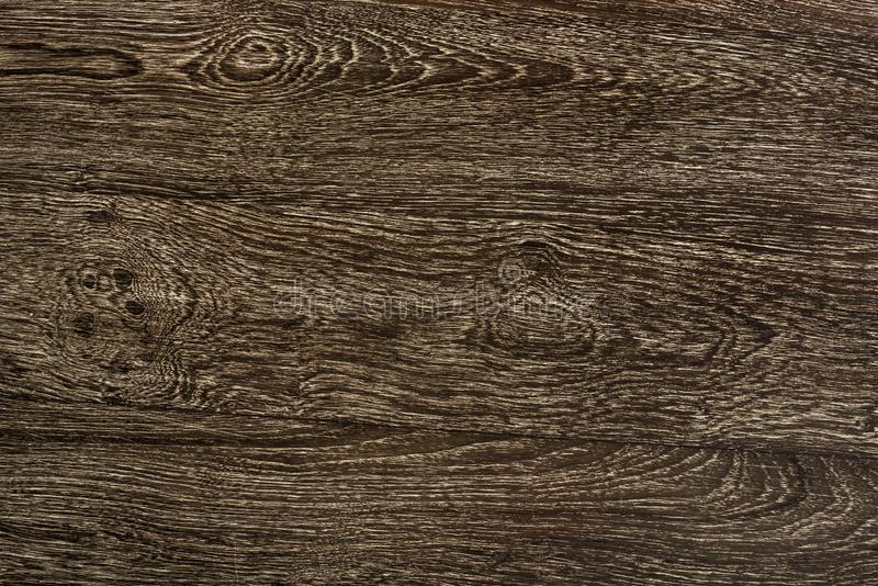 Zamyka w górę brązu drewniany floorboard textured tła zdjęcie royalty free