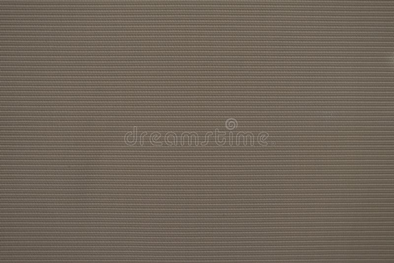 Zamyka w górę deseniowej brąz zasłony sukiennej tekstury dla tła obraz stock