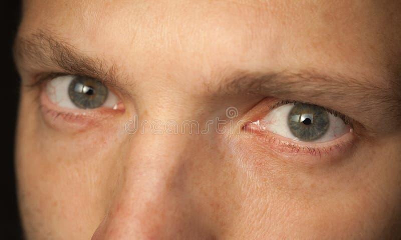 Zamyka w górę fotografii mężczyzna oczy obraz stock