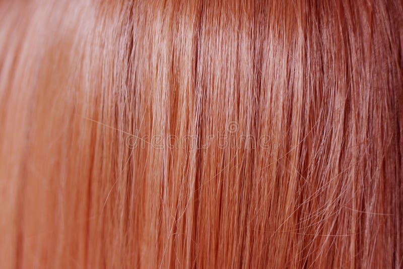Zamyka w górę gładkiego i prostego imbirowego czerwonego włosianego koloru fotografia stock
