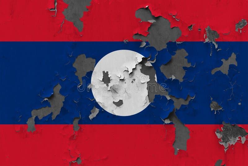 Zamyka w górę grungy, uszkadzającej i wietrzejącej Laos flagi na ścianie struga daleko farbę widzieć wśrodku powierzchni, obrazy royalty free