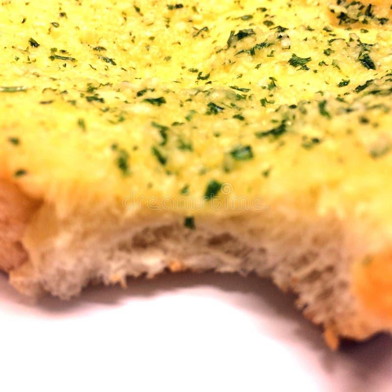 Zamyka w górę niedokończonego czosnku chleba obrazy royalty free