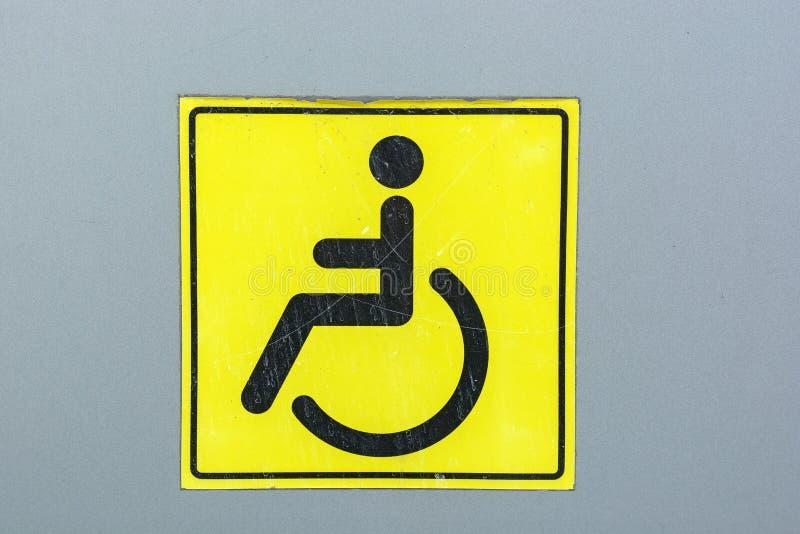 Zamyka w górę niepełnosprawnego znaka na ścianie fotografia royalty free
